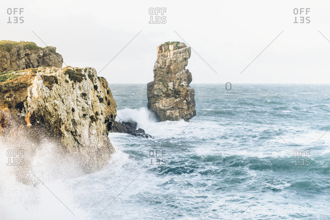 Waves crash against the rocky coast of Peniche, Portugal