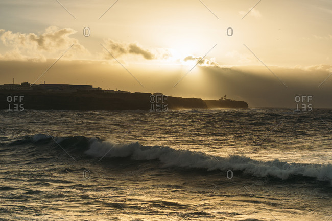 Peninsula at sunset from Papoa Beach in Peniche, Portugal