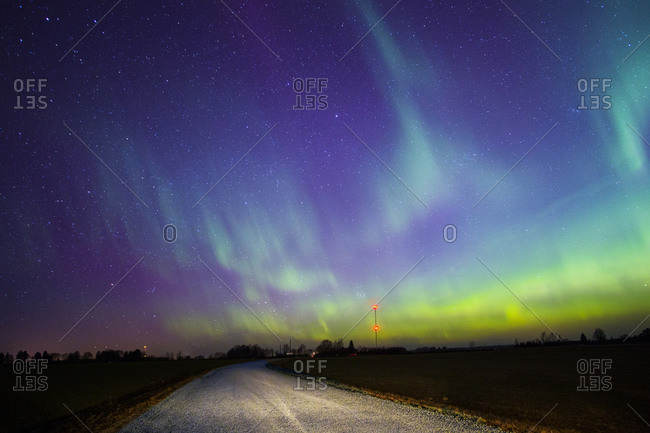 Northern lights over empty road
