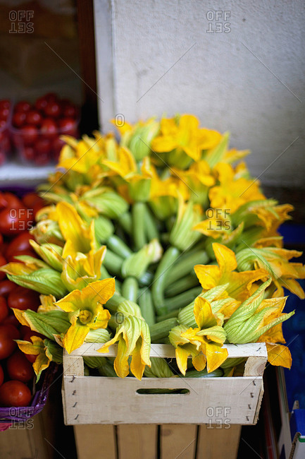 Plenty of fresh zucchini with flowers on sale at a market