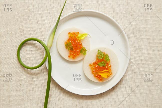Fish eggs dish on plate
