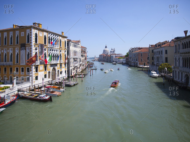 Venice, Italy - May 16, 2011: Boats on canal in city