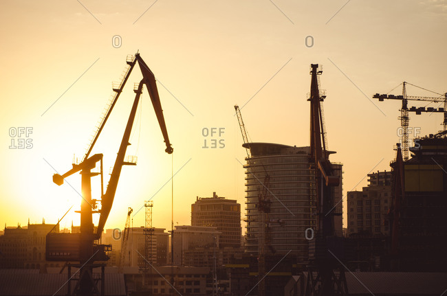 Crane on a construction site at sunset in Baku, Azerbaijan