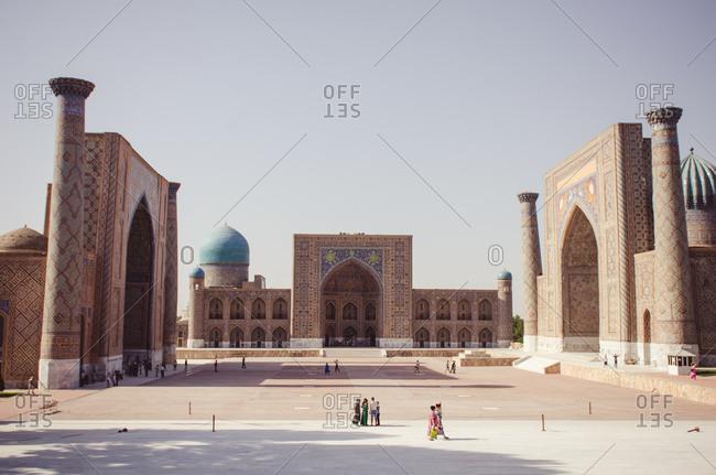 People walking at the Bibi-Khanym Mosque in Uzbekistan