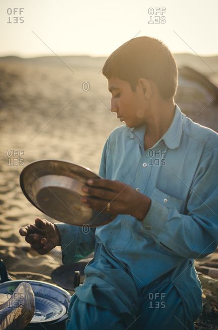 Thar Desert, India - November 10, 2014: Boy camping in the Thar Desert in Rajasthan, India