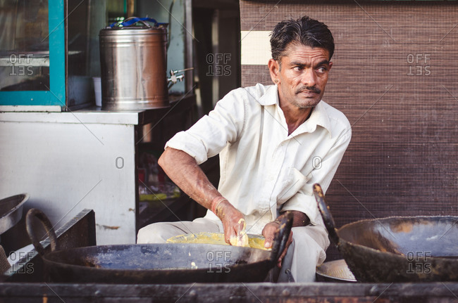 Jaisalmer, India - November 11, 2014: Man preparing food in Jaisalmer, Rajasthan, India