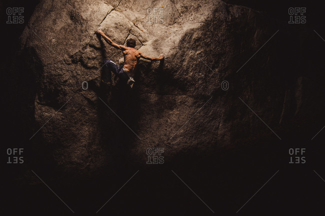 Man climbing on a steep cliff at Smoke Bluffs in BC, Canada
