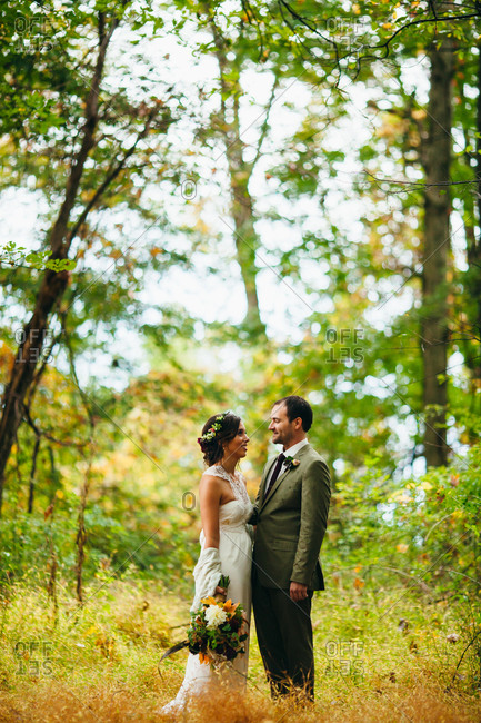 Newlyweds posing in a forest