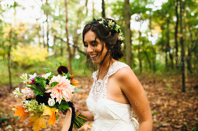Portrait of bride walking in the woods