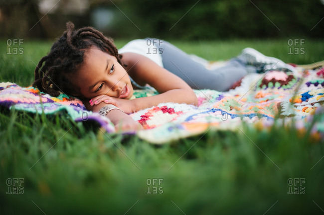 Young girl resting on a blanket