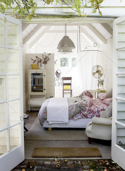 A bedroom with French doors