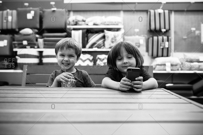 Children using a smartphone at a table