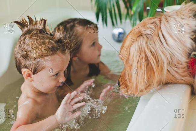 girl and boy bathing together
