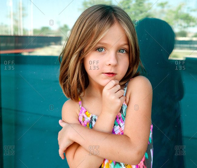 Portrait of little girl standing outside