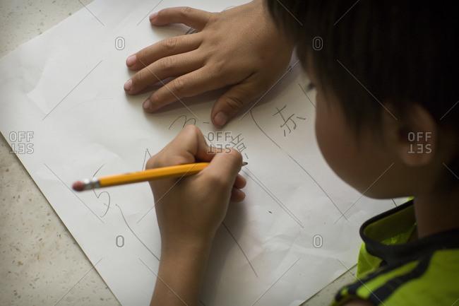 A Japanese boy doing his Japanese homework