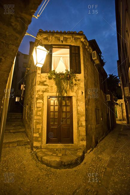 A home at dusk on a narrow street in Dubrovnik, Croatia