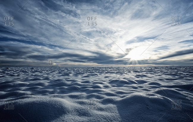 A snow covered field and a view to the horizon