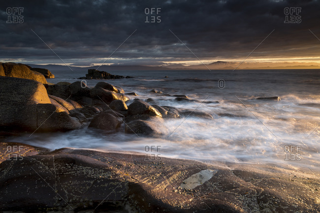Rocky seacoast at sunset