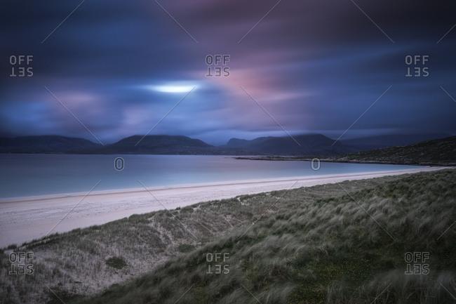 Sandy seacoast at dusk