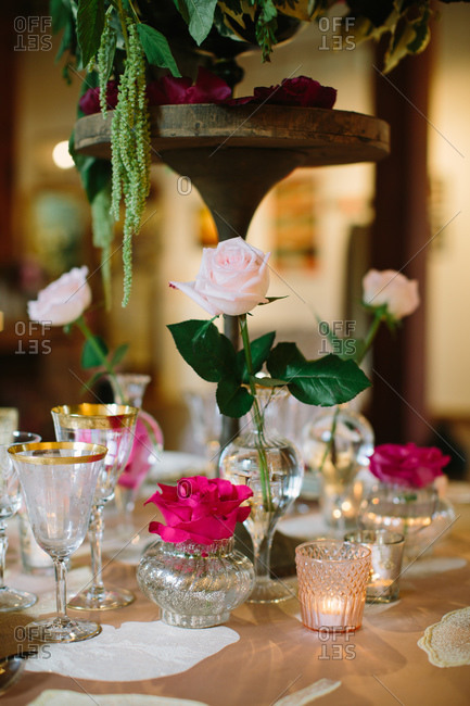 Roses and crystal glasses on a table