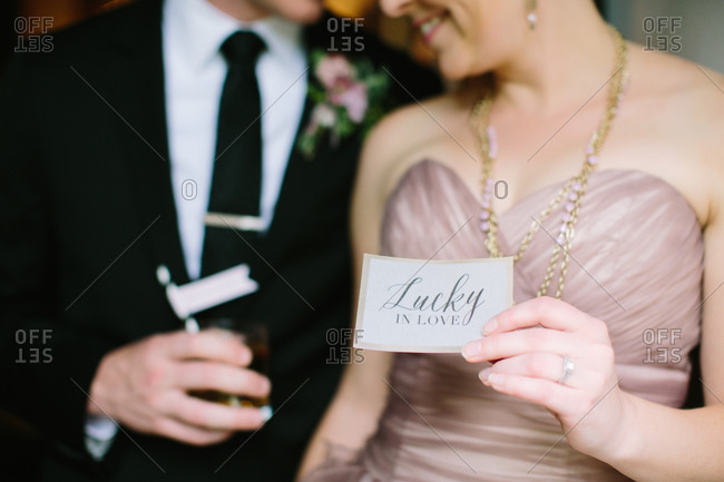 Bride holding a card
