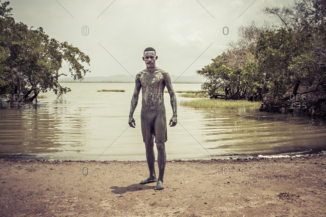Volcan del Totumo, Colombia - April 7, 2015: Boy covered in mud by inlet in Colombia