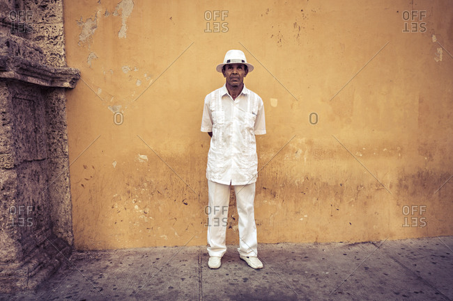 Cartagena, Colombia - April 22, 2015: Gentleman against wall of church in Cartagena, Colombia