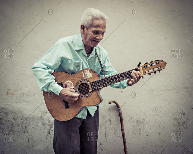 Cartagena, Colombia - April 22, 2015: Man singing and playing guitar in Cartagena, Colombia