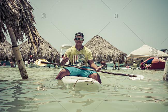 Cartagena, Colombia - April 24, 2015: Man in kayak in Caribbean sea off Cartagena