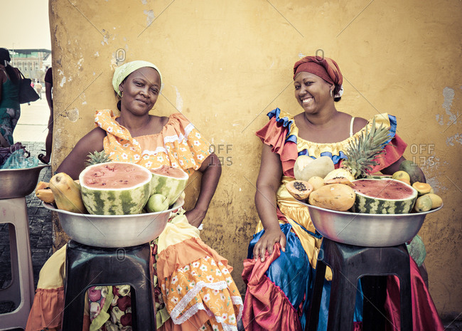 Cartagena, Colombia - April 24, 2015: Women selling fruit in Cartagena market place