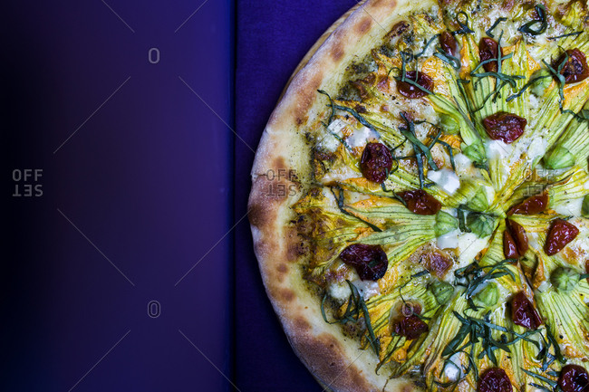 Vegetarian pizza with goat cheese and zucchini flowers