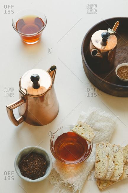 Tea in copper pots with biscotti