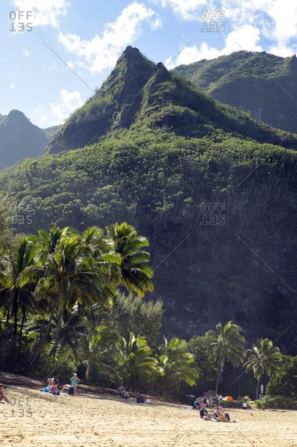 Hanalei, Hawaii - March 20, 2015: Tunnels Beach with palms, Haena Beach, Hanalei, Hawaii