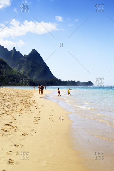 Hanalei, Hawaii - March 20, 2015: Tunnels Beach in front of mountains of Na Pali Coast, Haena Beach, Hanalei, Hawaii