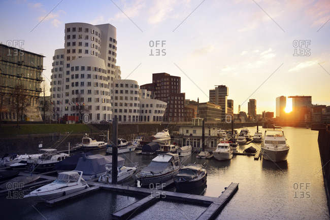 Dusseldorf, Germany - March 25, 2015: Media harbor with marina at sunset, Dusseldorf
