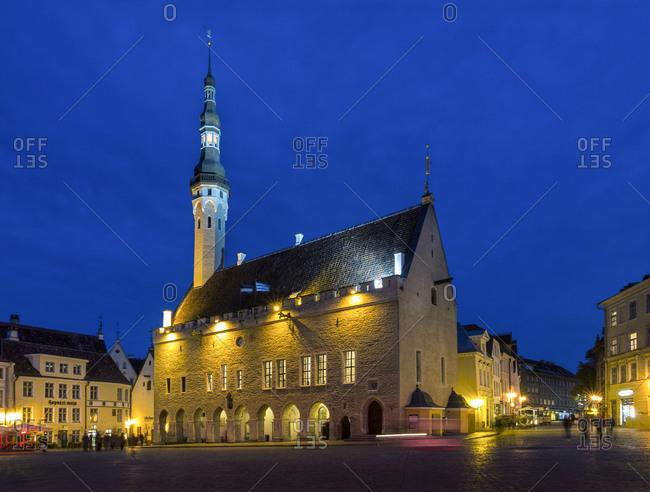 Illuminated town hall on town hall square at night, Tallinn, Estonia