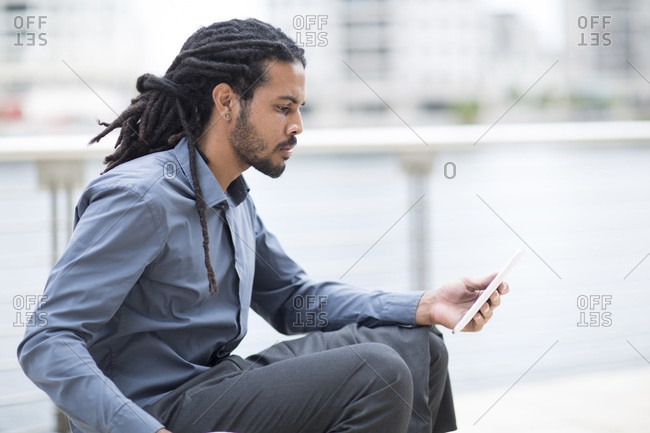 Businessman taking a break, checking emails