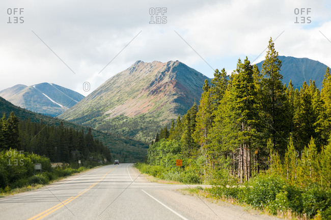 Remote highway through the mountains in the Yukon