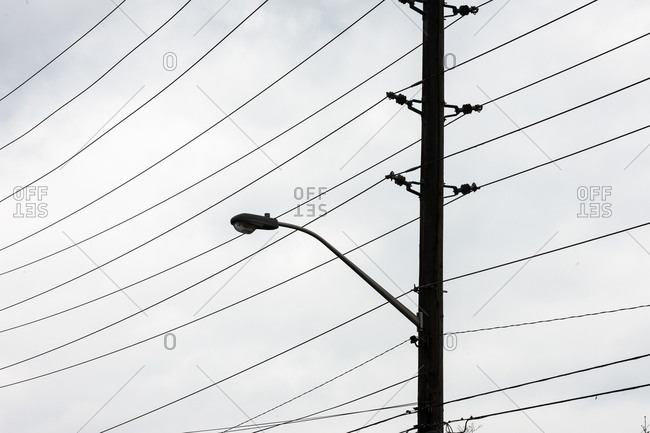 Street light and power lines form a graphic pattern