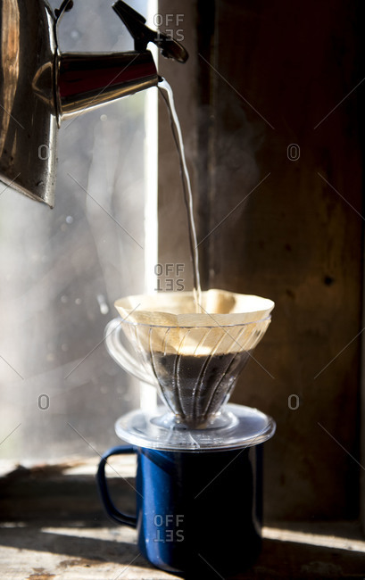 Hot water pouring into a pour over brewer