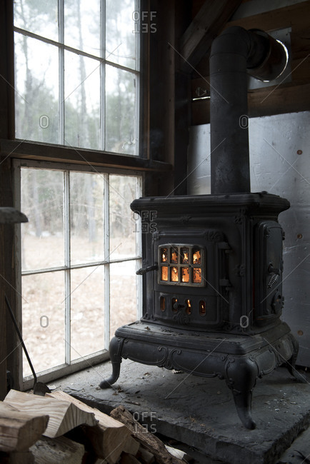 A wood stove in a rustic cabin