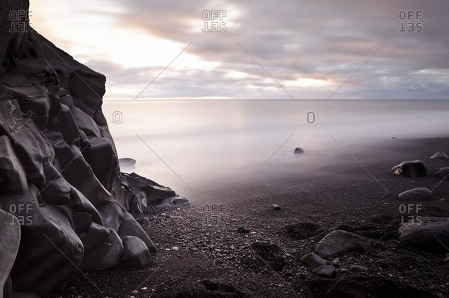 Wave-worn basaltic rock formation in Reynisfjara, Iceland
