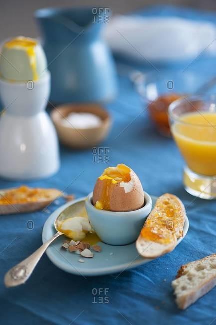 Breakfast scene with soft boiled egg