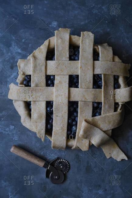 Finishing lattice crust on blueberry pie