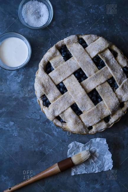 Blueberry pie ready to bake with cream wash and sugar topping
