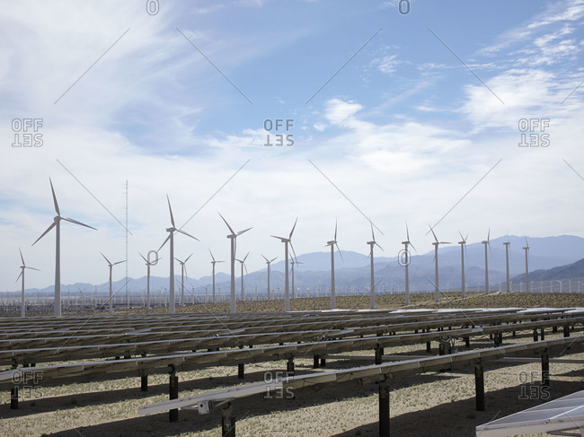 Solar panels and wind turbines in the desert in Palm Springs, California