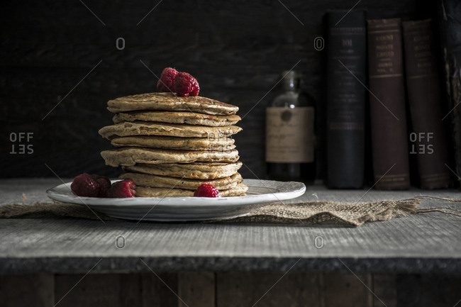 Raspberry pancakes served on a wooden table