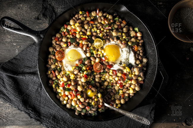 Texas caviar in a cast iron skillet served on a table