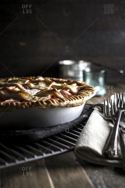 Strawberry apple pie on a cooling rack
