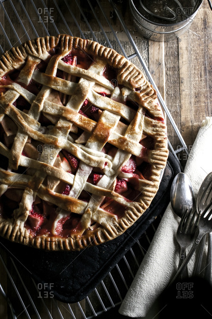 Strawberry apple pie served on a wood table